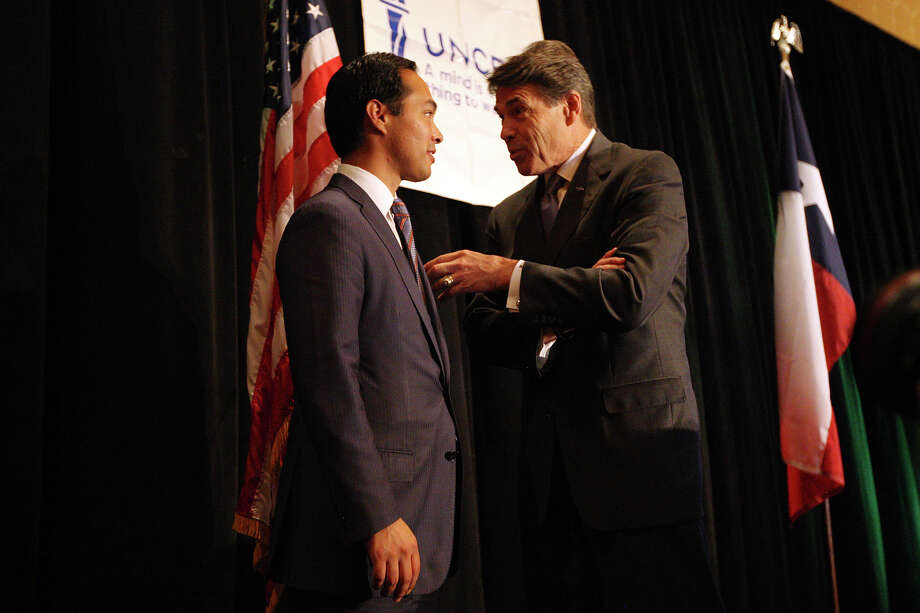 Gov. Rick Perry talks with Mayor Julián Castro after the United Negro College Fund South Texas Governor's Luncheon at the Grand Hyatt on Oct. 25, 2012. Photo: Jerry Lara, San Antonio Express-News / © 2012 San Antonio Express-News