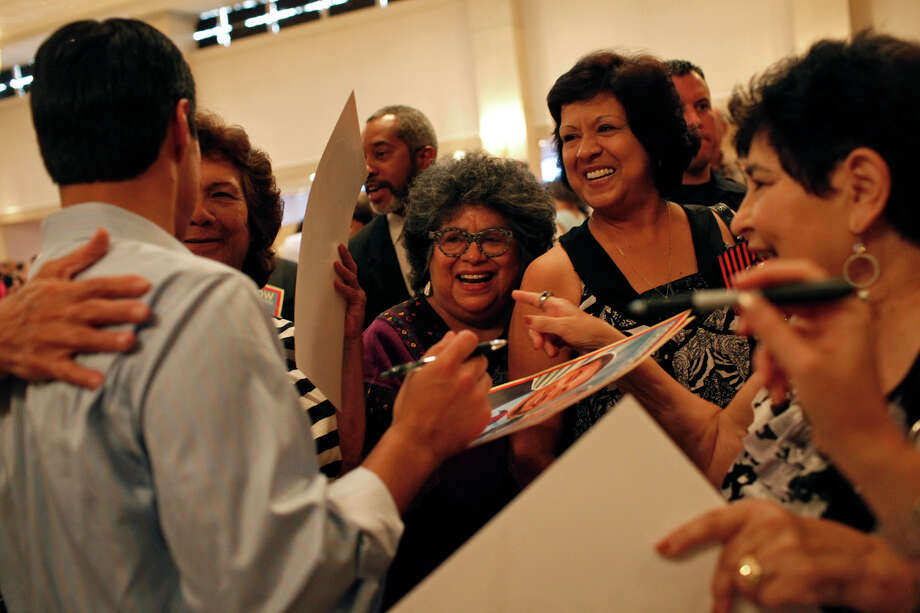 Mayor Julián Castro is embraced by supporters during the send-off party for his trip to the Democratic National Convention at the St. Paul Community Center in San Antonio on Sept. 1, 2012. Photo: Lisa Krantz, San Antonio Express-News / San Antonio Express-News