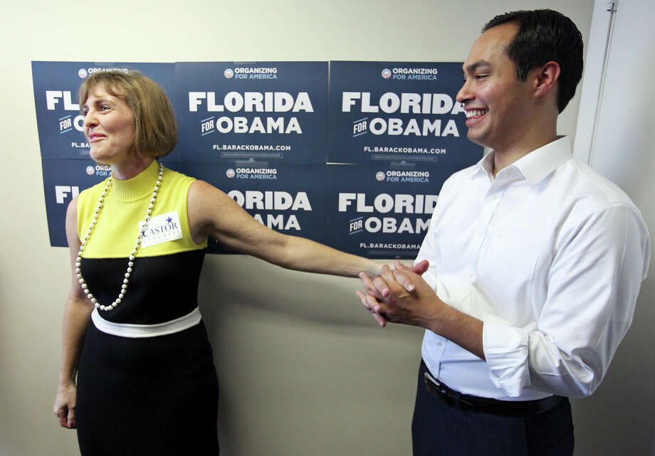 U.S. Rep. Kathy Castor, D-Florida, jokes with Mayor Julián Castro while answering questions from the media during the opening of the 100th field office for the Obama For America-Florida campaign on Sept. 29, 2012, in Tampa, Fla. Castor and Castro were joined by Tampa Mayor Bob Buckhorn (not pictured). The trio were on hand to rally the troops for canvassing. Photo: Edward A. Ornelas, San Antonio Express-News / © 2012 San Antonio Express-News