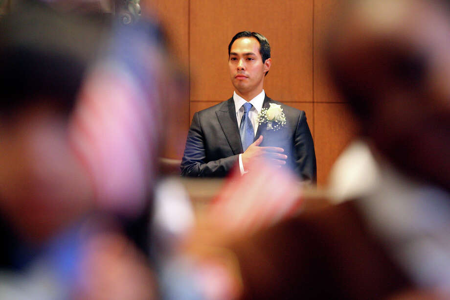 Mayor Julián Castro stands during the national anthem during the swearing-in ceremony held on June 17, 2011, at City Council Chambers. Photo: EDWARD A. ORNELAS, SAN ANTONIO EXPRESS-NEWS / © SAN ANTONIO EXPRESS-NEWS (NFS)