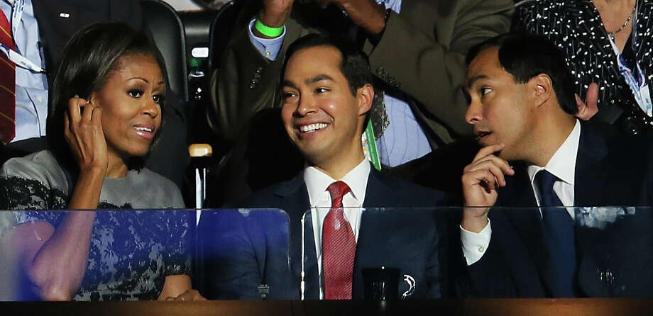 First lady Michelle Obama talks with Mayor Julián Castro (center) and his brother Joaquín Castro during Day 2 of the Democratic National Convention at Time Warner Cable Arena on Sept. 5, 2012, in Charlotte, N.C. Photo: Alex Wong, Getty Images / 2012 Getty Images