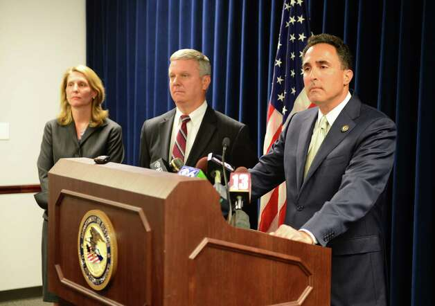 U.S. Attorney Richard Hartunian, right, comments on the corruption trial of former Senate Leader Joseph Bruno, as Assistant U.S, Attorney Elizabeth Coombe, left, and Assistant U.S. Attorney William Pericak, right, listen Friday afternoon, May 16, 2014, during a press conference at the James T. Foley U.S. Courthouse in Albany, N.Y. (Will Waldron/Times Union) Photo: WW / 00026783N