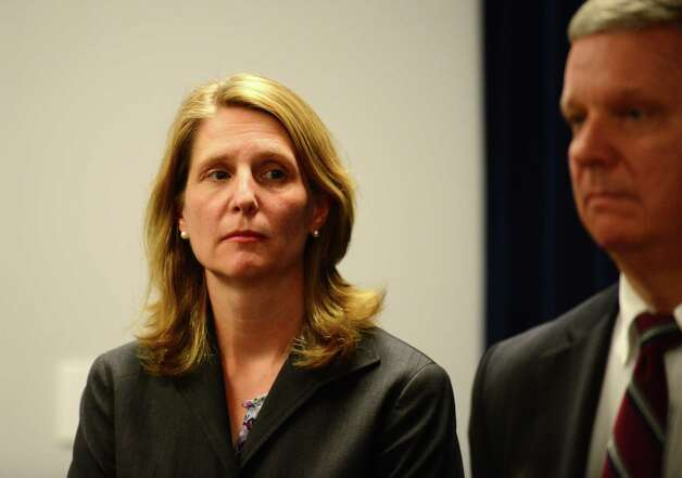 Assistant U.S, Attorney Elizabeth Coombe, left, and Assistant U.S. Attorney William Pericak, right, listen as U.S. Attorney Richard Hartunian comments on the corruption trial of former Senate Leader Joseph Bruno Friday afternoon, May 16, 2014, during a press conference at the James T. Foley U.S. Courthouse in Albany, N.Y. (Will Waldron/Times Union) Photo: WW / 00026783N