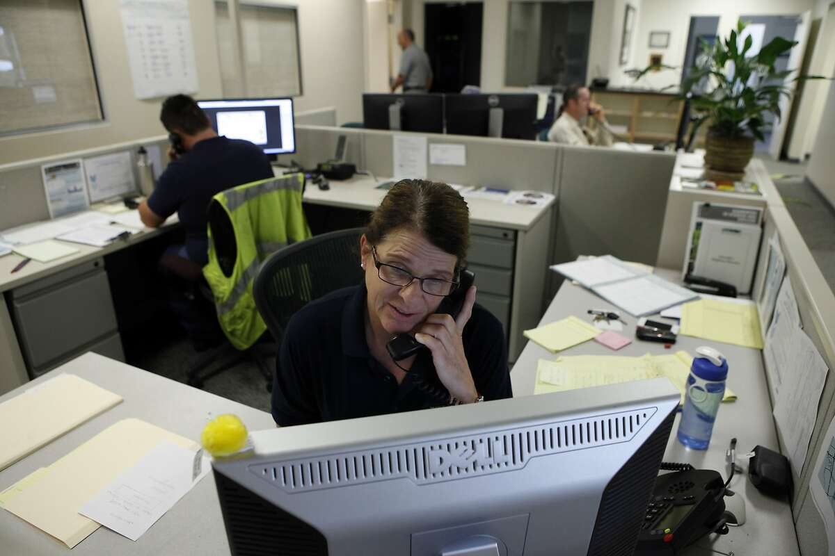 Water efficiency technician Jacklyn Cordes takes residents calls in the city's Drought Hotline Call Center in Pleasanton, CA, Friday May 16, 2014. The city of Pleasanton has made it mandatory for it's residents to comply with a 25 percent reduction in water usage to help combat persisting drought conditions.