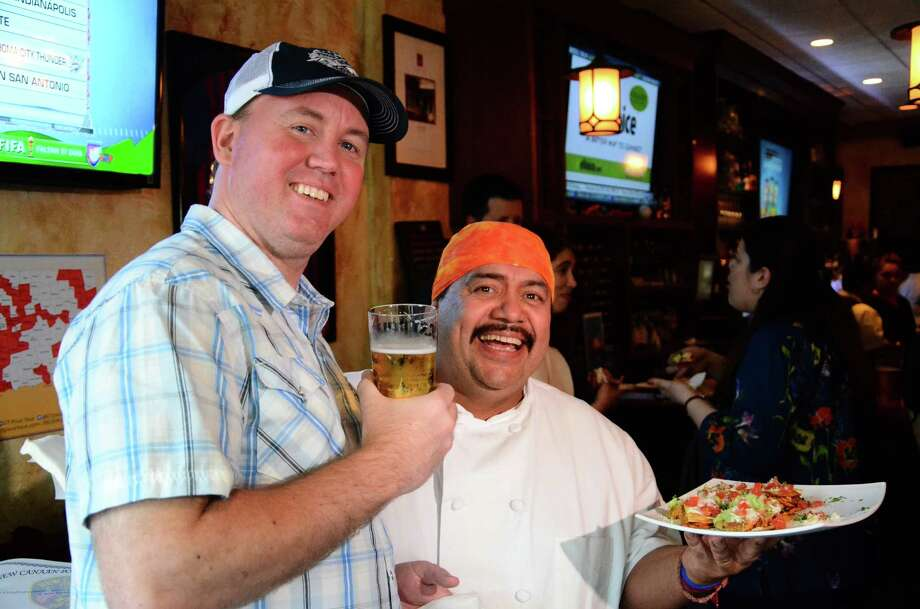 Todd Ruggere, who's touring the state to raise money for the Smilow Cancer Hospital at Yale-New Haven, stopped at Chef Luis, 129 Elm St., New Canaan, Conn., Friday night, May 16, 2014. Next to him is Luis Lopez, the owner. Photo: Nelson Oliveira / New Canaan News