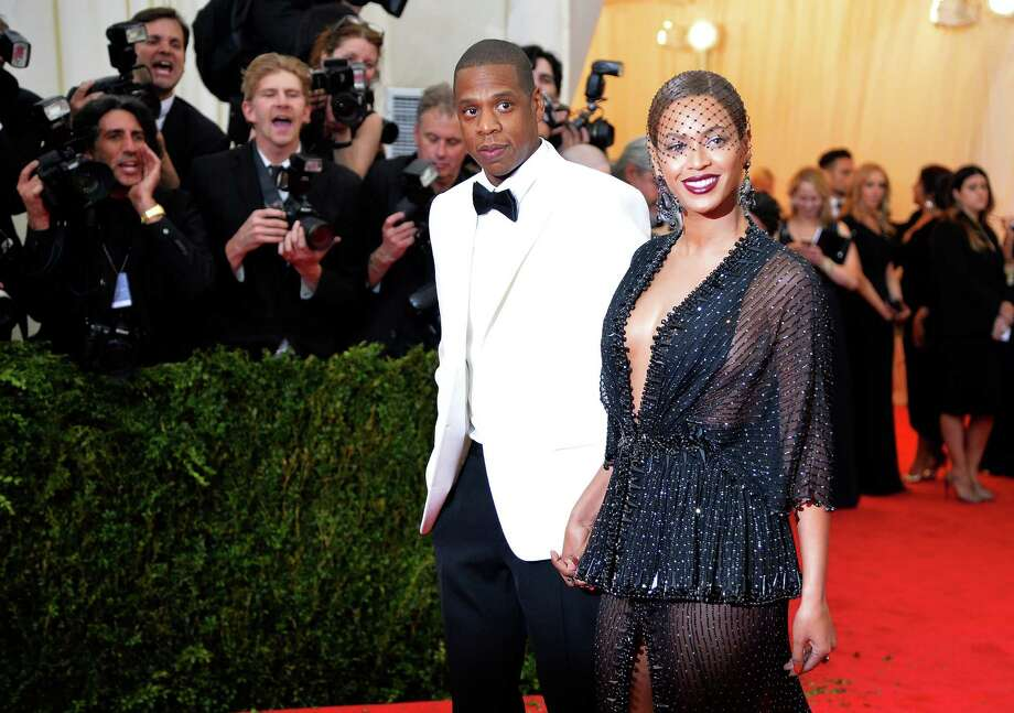 "NEW YORK, NY - MAY 05:  Jay-Z (L) and Beyonce attend the ""Charles James: Beyond Fashion"" Costume Institute Gala at the Metropolitan Museum of Art on May 5, 2014 in New York City.  (Photo by Mike Coppola/Getty Images) Photo: Mike Coppola, Staff / 2014 Getty Images"