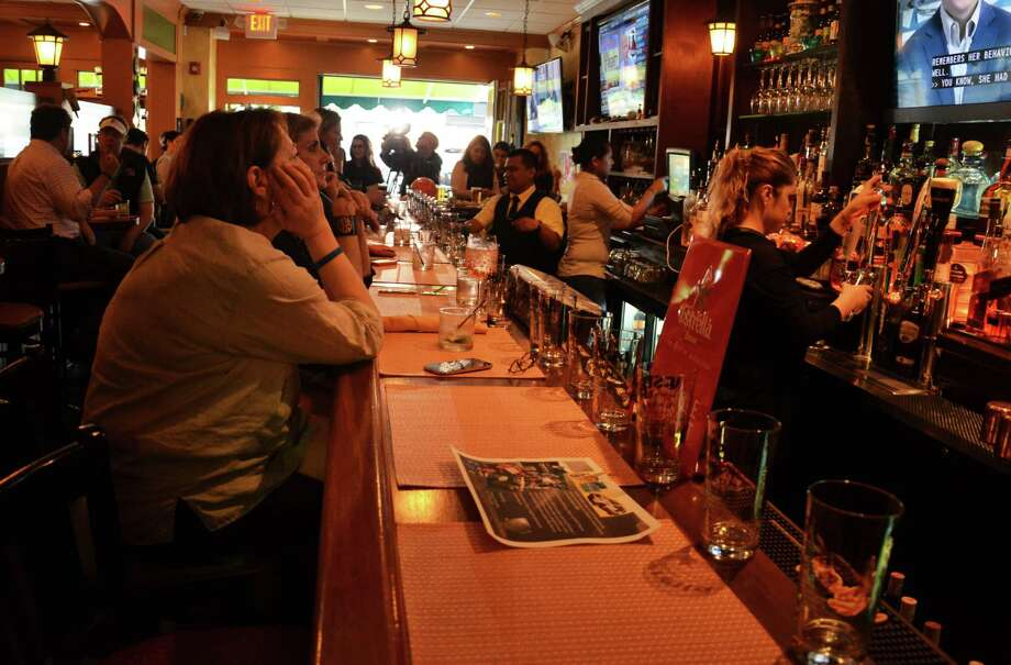 New Canaan's Chef Luis, 129 Elm St., was crowded Friday, May 16, 2014, as Todd Ruggere made another stop in his fundraising tour for the Smilow Cancer Hospital at Yale-New Haven. Ruggere is drinking a beer in all Connecticut towns and cities this year while collecting money for the hospital. Photo: Nelson Oliveira / New Canaan News