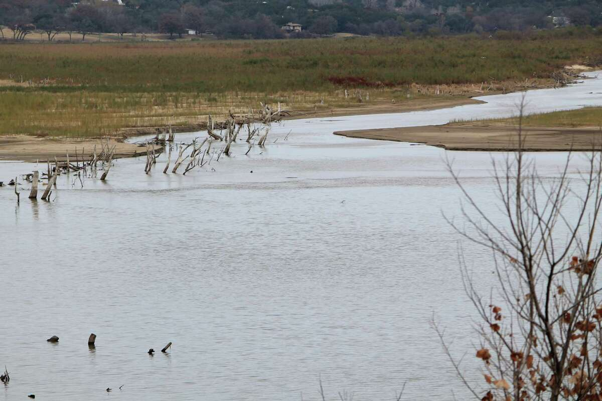 This undated photo shows the drought affected Brazos River in Denton, Texas, which feeds several lake systems including Possum Kingdom Lake, Lake Whitney and Lake Granbury. (AP Photo/Denton Record-Chronicle, Christian McPhate)
