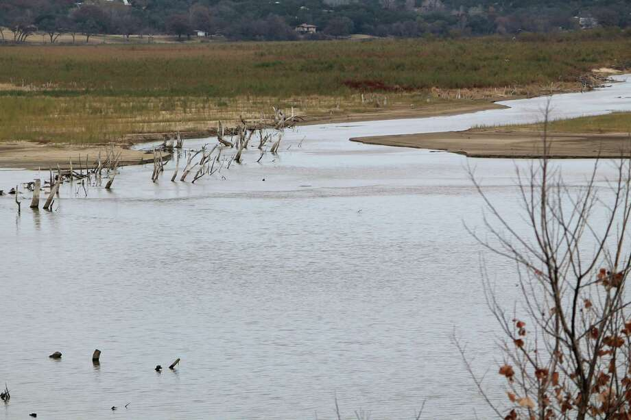 This undated photo shows the drought affected Brazos River in Denton, Texas, which feeds several lake systems including Possum Kingdom Lake, Lake Whitney and Lake Granbury.  (AP Photo/Denton Record-Chronicle, Christian McPhate) Photo: Christian McPhate, MBR / Denton Record-Chronicle
