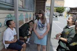 Vice Principal Karen Hammen, center, talks with students during recess at St. Peter's Catholic School in San Francisco, Calif., on Thursday, May 15, 2014. St. Peter's in the Mission has seen changes to the school as the neighborhood changes around it. The school is 95 percent Latino, but overall enrollment is down in the neighborhood that is seeing Latinos leave because of gentrification.