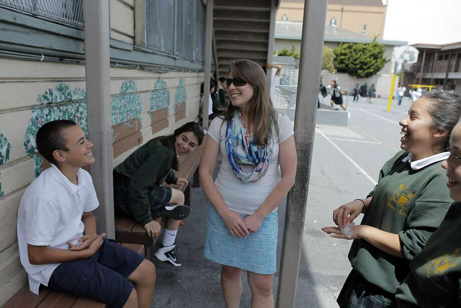 Vice Principal Karen Hammen (center) chats with students during recess at St. Peter's Catholic School on Florida Street in S.F.'s Mission District. Photo: Carlos Avila Gonzalez, The Chronicle