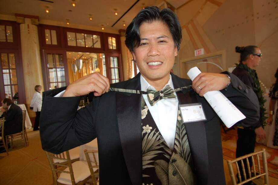 Eric Tao, former president of the Hawaii Chamber of Commerce of Northern California, shows off his aloha-print tuxedo vest and tie at the 2010 Five Star Aloha Gala. Photo: Jeanne Cooper, SFGate