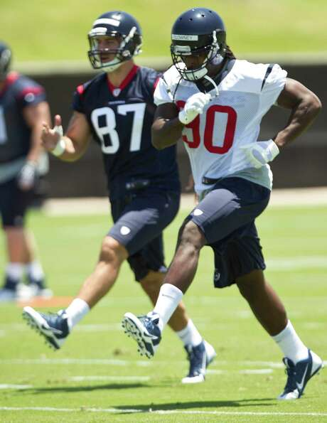 Third-round pick C.J. Fiedorowicz (87) and first-rounder Jadeveon Clowney are through with the first act of their pro careers with rookie minicamp and now it's on to organized team activities next week. Photo: Brett Coomer, Staff / © 2014  Houston Chronicle