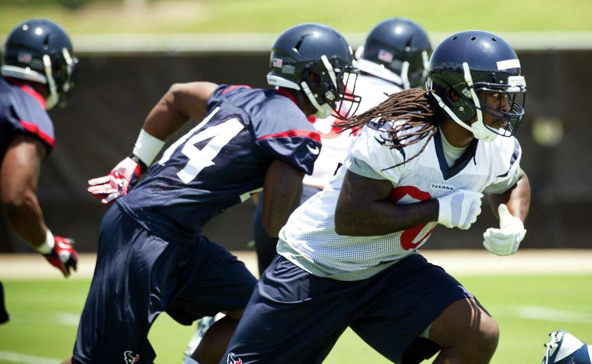 Outside linebacker Jadeveon Clowney, right, admits he has a lot to learn during the Texans' rookie minicamp at the Methodist Training Center.