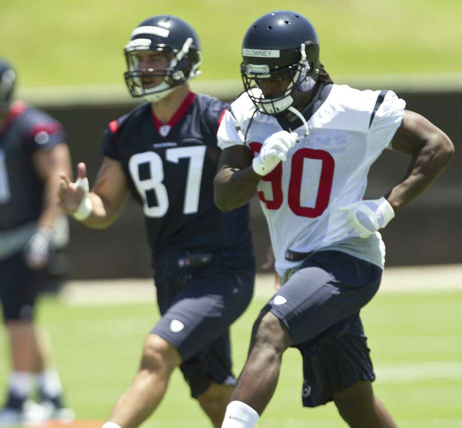 Houston draftees Jadeveon Clowney (right) and C.J. Fiedorowicz warm up before their first practice as members of the Texans. The team opened its rookie minicamp Friday. Photo: Brett Coomer / Houston Chronicle / © 2014  Houston Chronicle