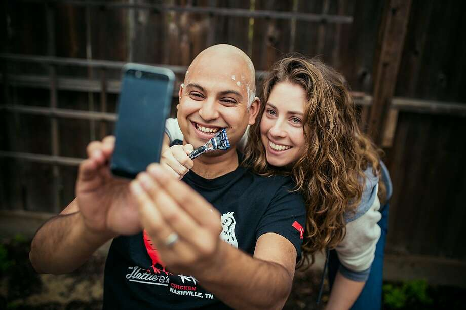 Rohin Das, with wife Adriana Anavitarte by his side, shaves off his hair before starting chemotherapy. Their wedding photographers, Jaime and Dennis Viera of Viera Photographics, documented the head-shaving process. Photo: Viera Photographics