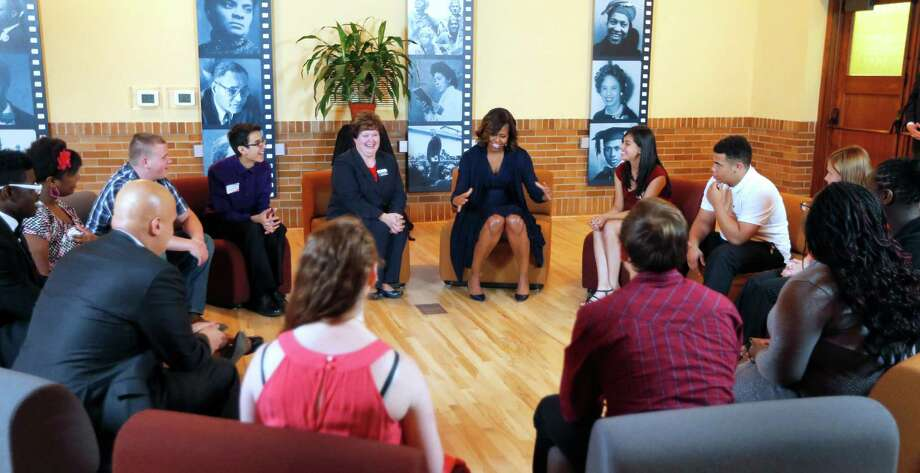 First lady Michelle Obama leads the discussion Friday with high school students at Monroe School in Topeka, Kan. It has been 60 years since Brown v. Board of Education was filed to end racial discrimination. Photo: Orlin Wagner, STF / AP
