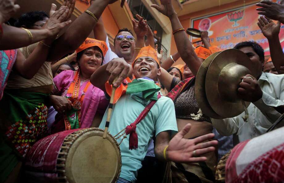 Supporters of Indian opposition leader Narendra Modi celebrate in Gauhati on Friday after their party won national elections in a landslide. Photo: Anupam Nath, STF / AP