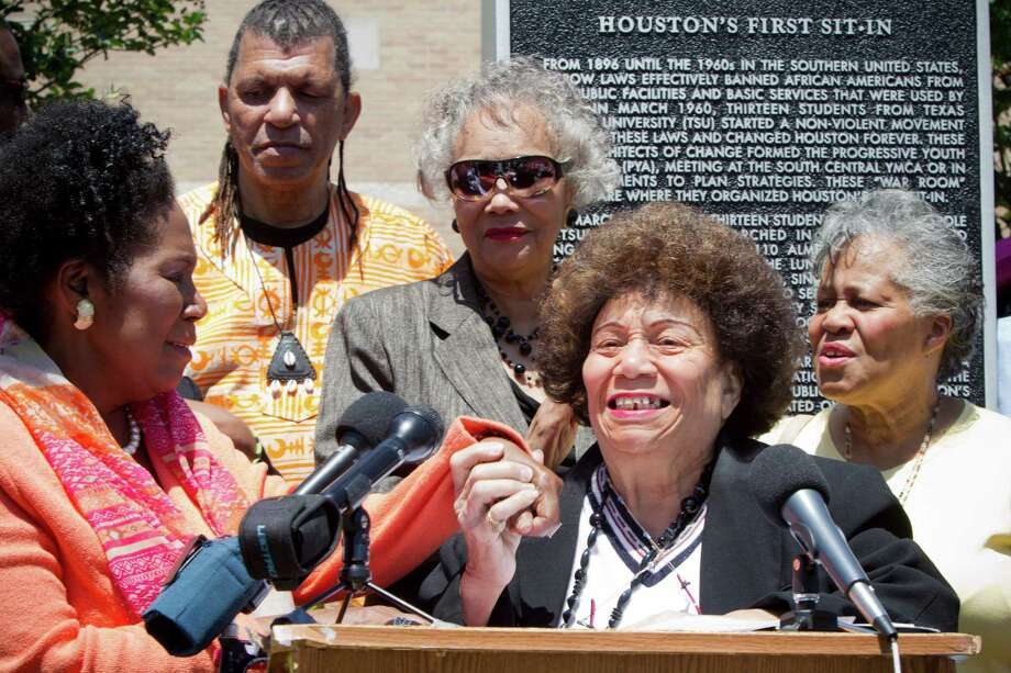 SOUTHMORE STATION:Louis C. Ray, center, holds the hand of  U.S. Rep. Sheila Jackson Lee, left, in appreciation for her efforts to preserve the Southmore Station post office. Photo: Marie D. De Jesus, Staff / © 2014 Houston Chronicle