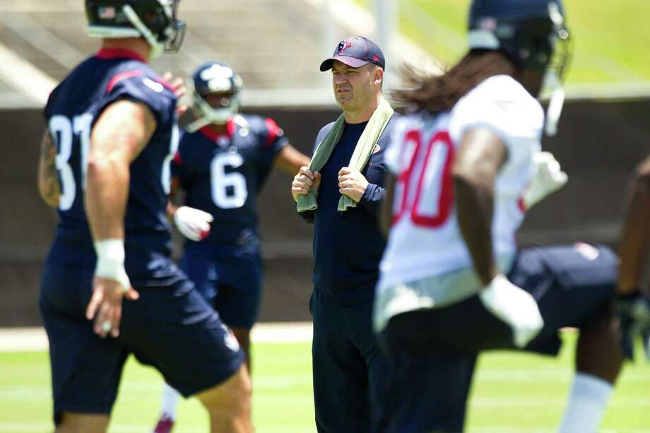 Bill O'Brien, center, is actually the most important rookie in the Texans minicamp as the first-year coach attempts to learn all he can about his new players, both on the field and, just as crucially, off of it. Photo: Brett Coomer, Staff / © 2014  Houston Chronicle