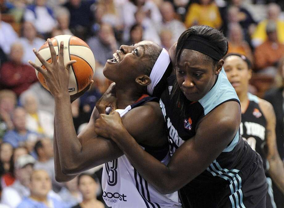 Chiney Ogwumike, in her WNBA debut with Connecticut, is fouled by Tina Charles. Photo: Fred Beckham, Associated Press