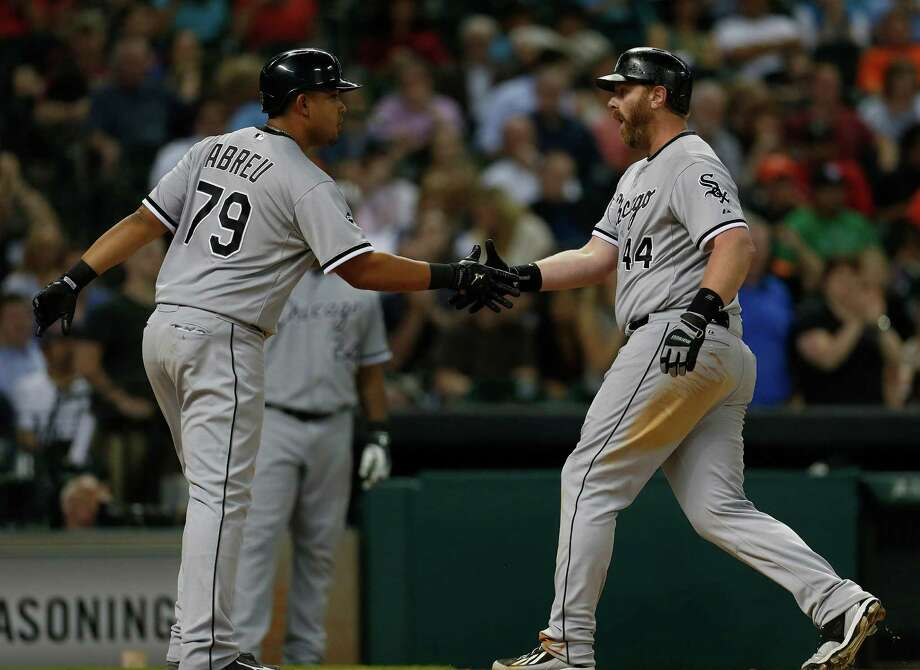 White Sox designated hitter Adam Dunn (44) celebrates with Jose Abreu (79) after Dunn's three-run homer in the sixth inning of Friday night's 7-2 victory over the Astros at Minute Maid Park. Photo: Karen Warren, Staff / © 2014 Houston Chronicle