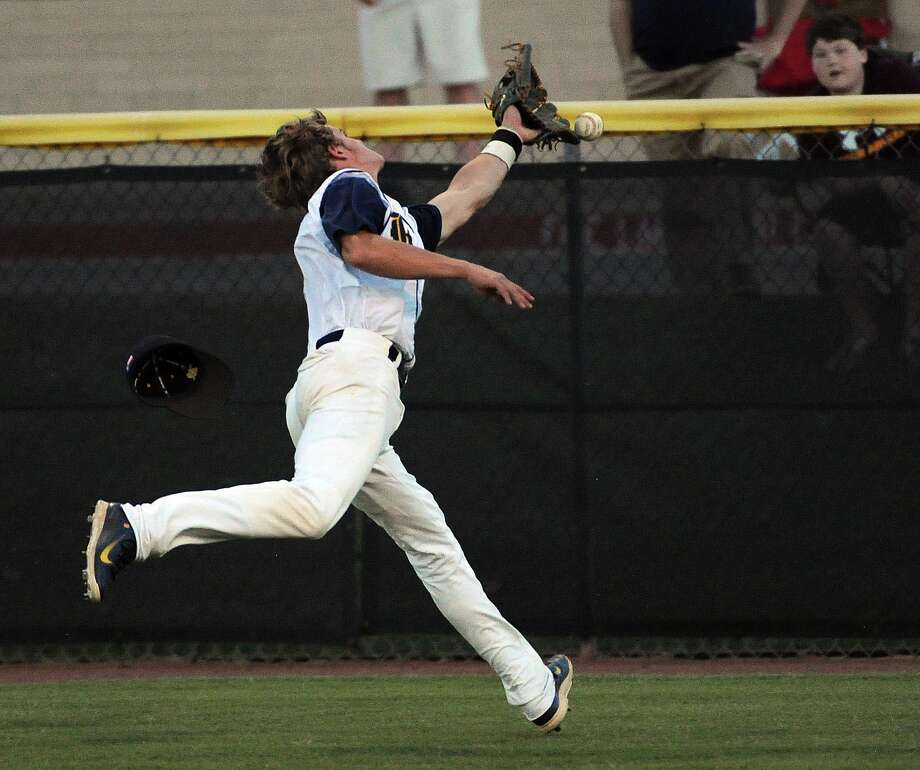 Cy-Ranch right fielder Dalton Stark can't make the catch during the third inning of a high school baseball playoff game against Cy-Fair, Friday, May 16, 2014, at Cy-Woods High School in Cypress. Photo: Eric Christian Smith, For The Chronicle