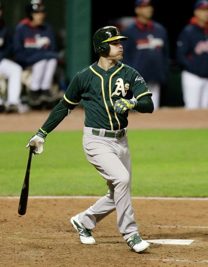 Oakland Athletics' Josh Reddick watches the ball after hitting a two-run home run off Cleveland Indians starting pitcher Carlos Carrasco in the seventh inning of a baseball game, Friday, May 16, 2014, in Cleveland. Derek Norris scored. (AP Photo/Tony Dejak) ORG XMIT: OHTD111 Photo: Tony Dejak / AP