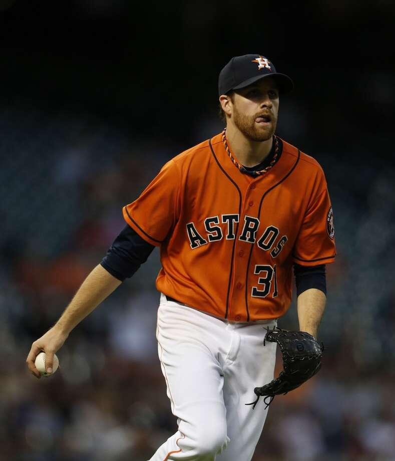 Astros starting pitcher Collin McHugh makes the throw to first base. Photo: Karen Warren, Houston Chronicle