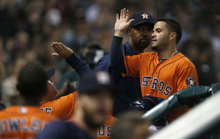 Astros second baseman Jose Altuve celebrates after scoring on a single. Photo: Karen Warren, Houston Chronicle