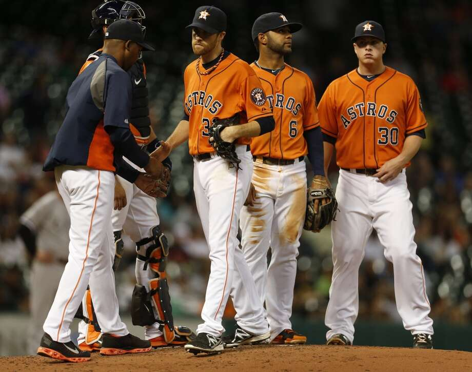 Starter Collin McHugh is pulled from the game in the sixth inning. Photo: Karen Warren, Houston Chronicle
