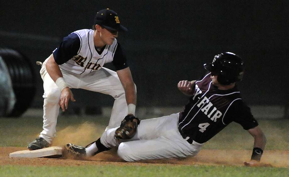 Cy-Fair's Clayton Kopecky, right, steals third base past Cy Ranch's Masen Hibbeler during the ninth inning of Friday's playoff game at Cy Woods High School. Photo: Eric Christian Smith, Freelance