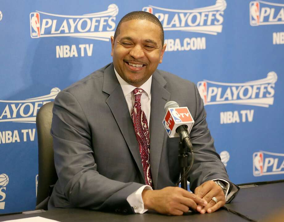 LOS ANGELES, CA - APRIL 29:  Head coach Mark Jackson of the Golden State Warriors laughs after being asked a question at a press conference before playing the Los Angeles Clippers in Game Five of the Western Conference Quarterfinals during the 2014 NBA Playoffs at Staples Center on April 29, 2014 in Los Angeles, California.   NOTE TO USER: User expressly acknowledges and agrees that, by downloading and or using this photograph, User is consenting to the terms and conditions of the Getty Images License Agreement.  (Photo by Stephen Dunn/Getty Images) Photo: Stephen Dunn, Getty Images