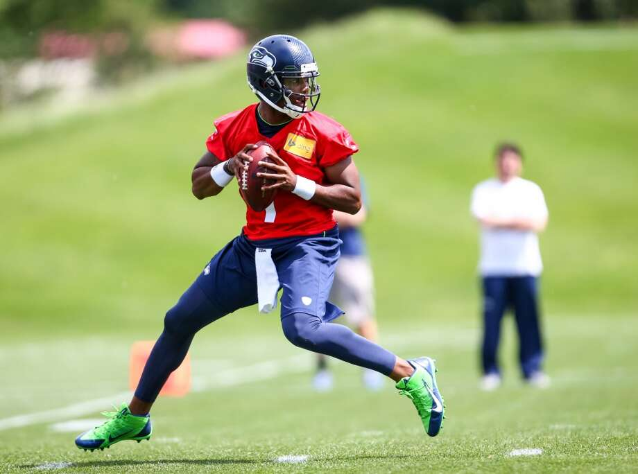 Quarterback Keith Price prepares to throw during Seattle Seahawks Rookie Minicamp on Friday, May 16, 2014 at the Virginia Mason Athletic Center in Renton. (Joshua Trujillo, seattlepi.com) Photo: JOSHUA TRUJILLO, SEATTLEPI.COM