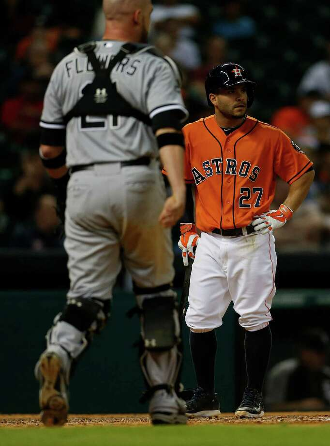 Jose Altuve, right, doesn't like what he sees after popping up to Chicago's Tyler Flowers. Photo: Karen Warren, Staff / © 2014 Houston Chronicle