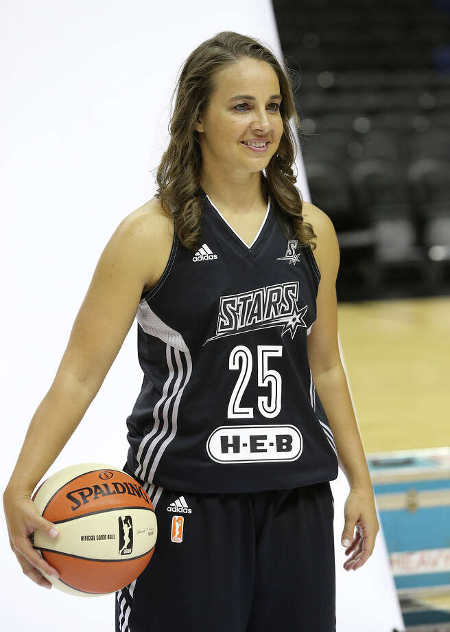 Becky Hammon steps into the portrait area as the Stars hold media day at the AT&T Center May 9, 2014. Photo: For The San Antonio Express-News