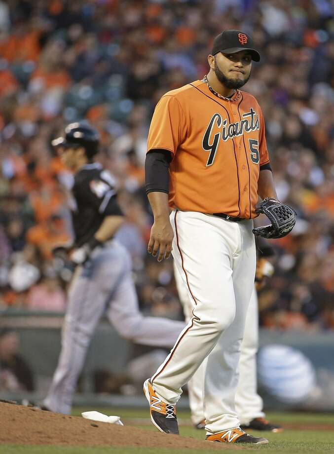 Fill-in starter Yusmeiro Petit takes a dim view of Derek Dietrich's two-run homer. Photo: Eric Risberg, Associated Press