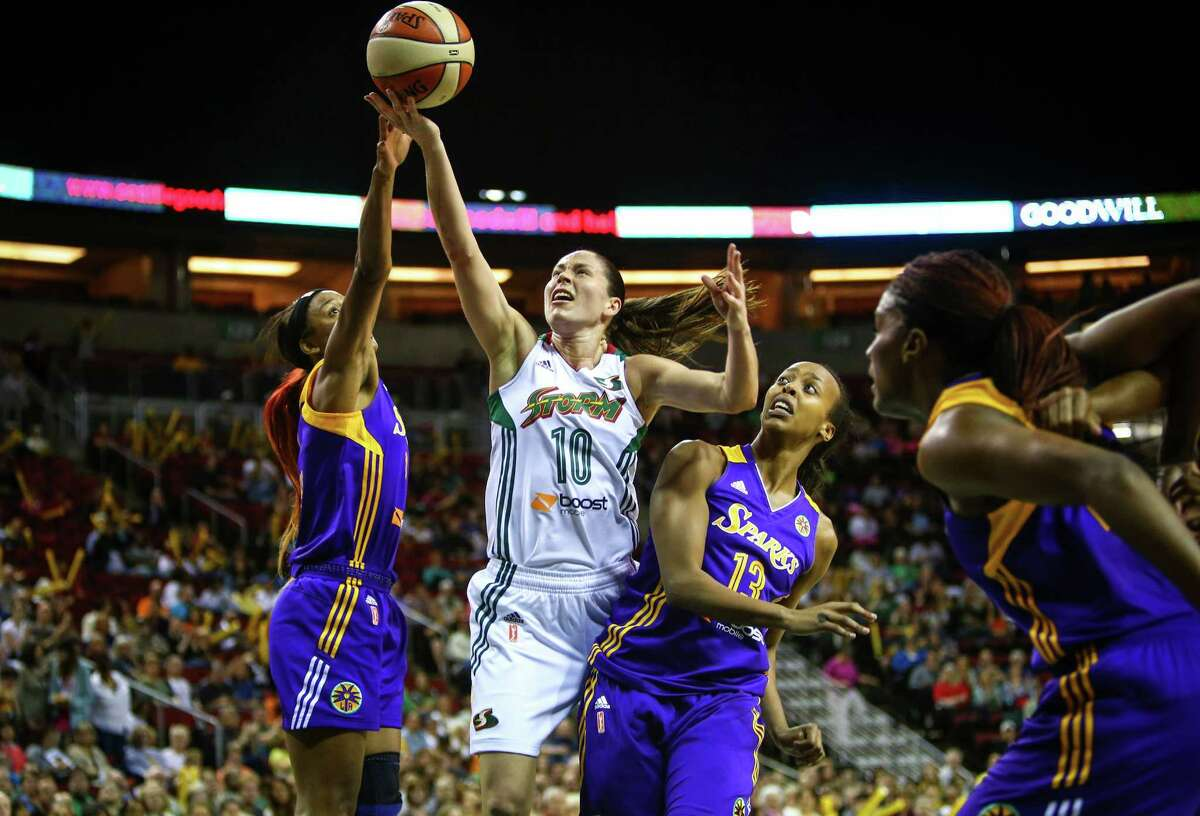 Sue Bird goes to the hoop against the Los Angeles Sparks players during the Seattle Storm season opener on Friday, May 16, 2014 at KeyArena in Seattle.