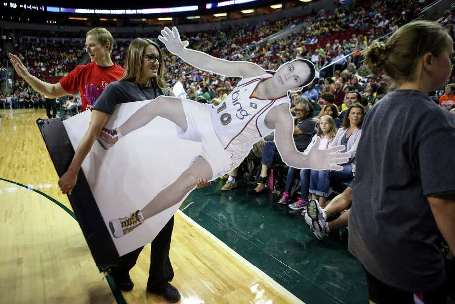 An image of Sue Bird is carried during the Seattle Storm season opener on Friday, May 16, 2014 at KeyArena in Seattle. Photo: JOSHUA TRUJILLO, SEATTLEPI.COM / SEATTLEPI.COM