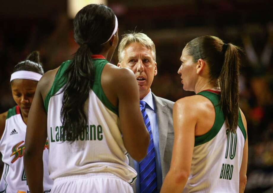 Storm coach Brian Agler talks to players Crystal Langhorn and Sue Bird during the Seattle Storm season opener on Friday, May 16, 2014 at KeyArena in Seattle. Photo: JOSHUA TRUJILLO, SEATTLEPI.COM / SEATTLEPI.COM