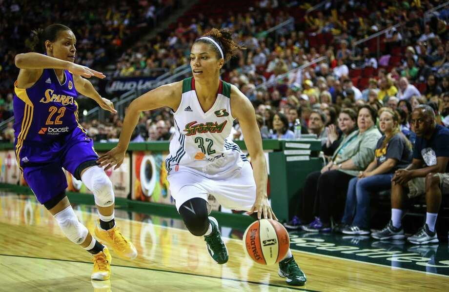 Storm player Alysha Clark drives to the hoop during the Seattle Storm season opener on Friday, May 16, 2014 at KeyArena in Seattle. Photo: JOSHUA TRUJILLO, SEATTLEPI.COM / SEATTLEPI.COM