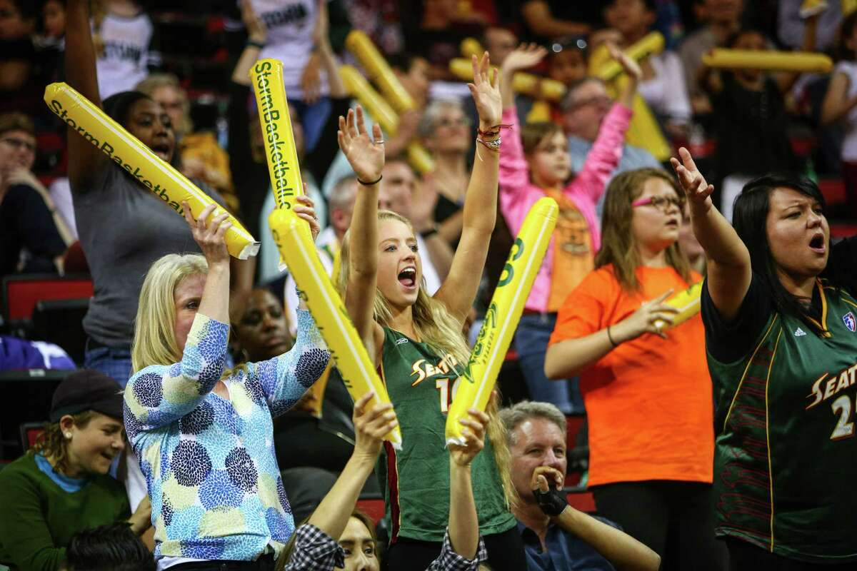 Fans cheer during the Seattle Storm season opener on Friday, May 16, 2014 at KeyArena in Seattle.