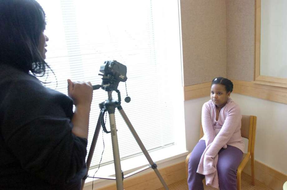 """Sade Chenet takes her place in front of the camera as Leslie Addy asks her questions during auditions for a musical about the game of chess Saturday, February 13, 2010 at Greenwich Library's meeting room. Addy's mother Vicki Camacho wrote a short musical which features the """"Chess Song"""" in an effort to teach children the basic movements of the game. She is now filming it to broadcast on Cablevision. Photo: Keelin Daly / Greenwich Time"""