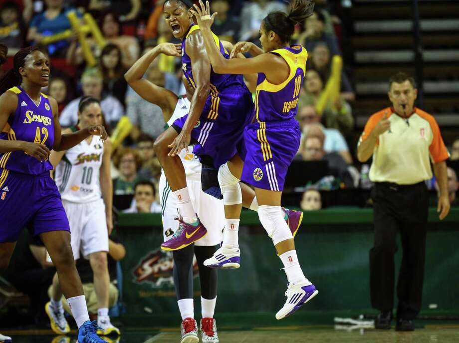 Los Angeles Sparks players Alana Beard and Lindsey Harding (10) celebrate a play during the Seattle Storm season opener on Friday, May 16, 2014 at KeyArena in Seattle. Photo: JOSHUA TRUJILLO, SEATTLEPI.COM / SEATTLEPI.COM