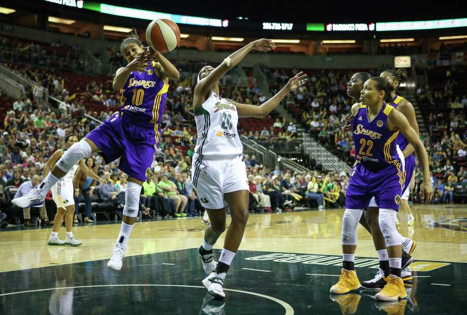 Los Angeles Sparks player Lindsey Harding swats the ball away from Storm player Camille Little during the Seattle Storm season opener on Friday, May 16, 2014 at KeyArena in Seattle. Photo: JOSHUA TRUJILLO, SEATTLEPI.COM / SEATTLEPI.COM