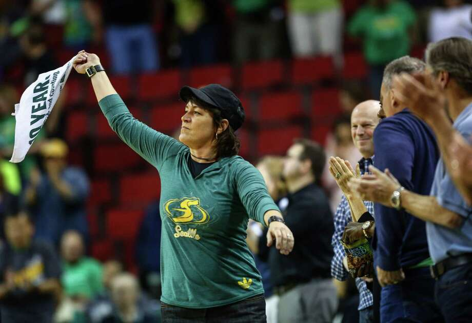 Shellie Hart helps cheer on the Storm during the Seattle Storm season opener on Friday, May 16, 2014 at KeyArena in Seattle. Photo: JOSHUA TRUJILLO, SEATTLEPI.COM / SEATTLEPI.COM
