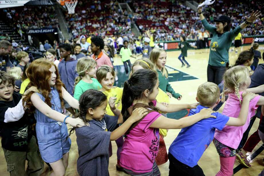 Young fans dance on the court during the Seattle Storm season opener on Friday, May 16, 2014 at KeyArena in Seattle. Photo: JOSHUA TRUJILLO, SEATTLEPI.COM / SEATTLEPI.COM