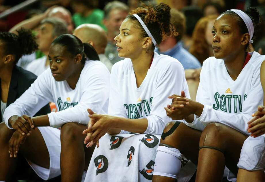 Storm player Alysha Clark, center, sits on the bench with teammates during the Seattle Storm season opener on Friday, May 16, 2014 at KeyArena in Seattle. Photo: JOSHUA TRUJILLO, SEATTLEPI.COM / SEATTLEPI.COM