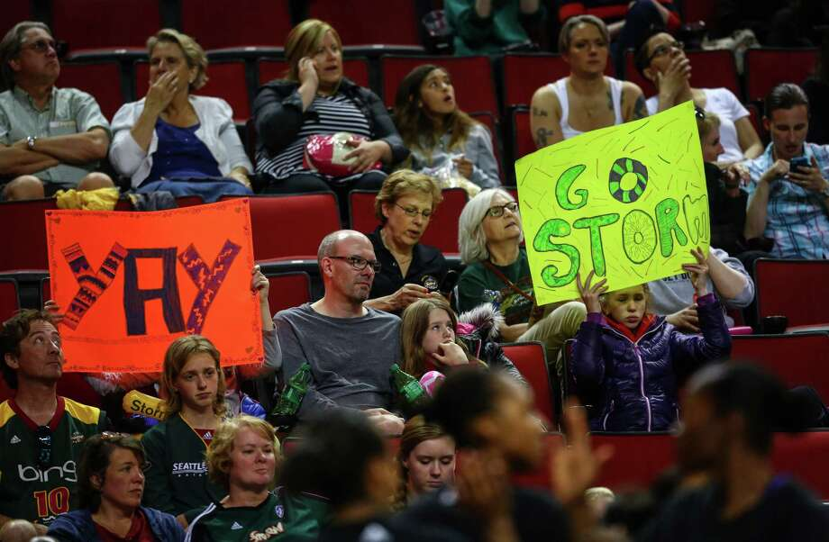 Fans hold up signs during the Seattle Storm season opener on Friday, May 16, 2014 at KeyArena in Seattle. Photo: JOSHUA TRUJILLO, SEATTLEPI.COM / SEATTLEPI.COM