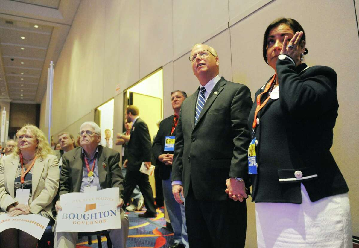 Danbury Mayor Mark Boughton and his wife, Phyllis Boughton, watch Mark's campaign video during the Connecticut Republican Gubernatorial Nomination at the Connecticut Republican Convention at the Mohegan Sun Uncas Ballroom in Uncasville, Conn. Saturday, May 17, 2014. Tom Foley, of Greenwich, beat candidates Mark Boughton, John McKinney, Joe Vicsonti and Mark Lauretti to face incumbent Democrat Gov. Dannel P. Malloy in the Connecticut race for governor.